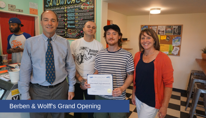 Commissioner of Planning Steven Strichman and Deputy Mayor Kurzejeski present owners Joey Berben and Max Wolff with a certificate during the grand opening of Berben and Wolff's Vegan Deli