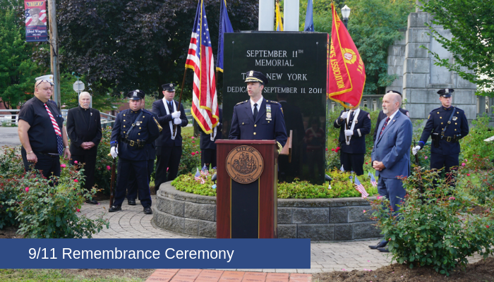 Police Chief Brian Owens speaks standing behind a podium during an outdoor ceremony at the City of Troy's 9/11 Memorial Park in Lansingburgh.