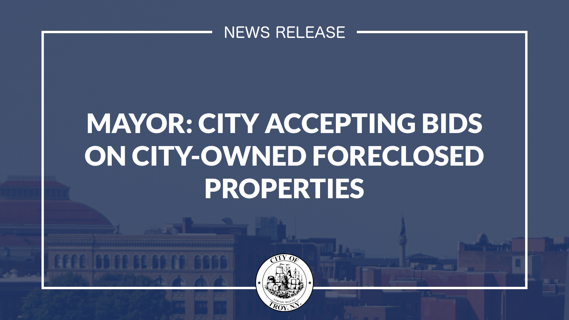 White text against transparent blue background. Text reads Mayor: City Accepting Bids on City-Owned Foreclosed Properties. The downtown Troy skyline is partially visible in the background