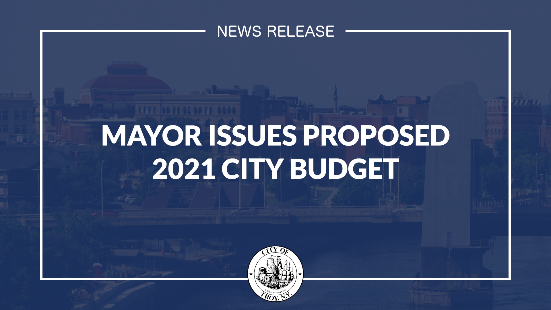 White text against transparent blue background. Text reads Mayor Issues Proposed 2021 City Budget
