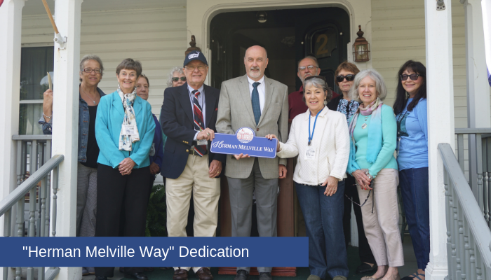 Mayor Patrick Madden poses with members of the Lansingburgh Historical Society during the dedication of Herman Melville Way.