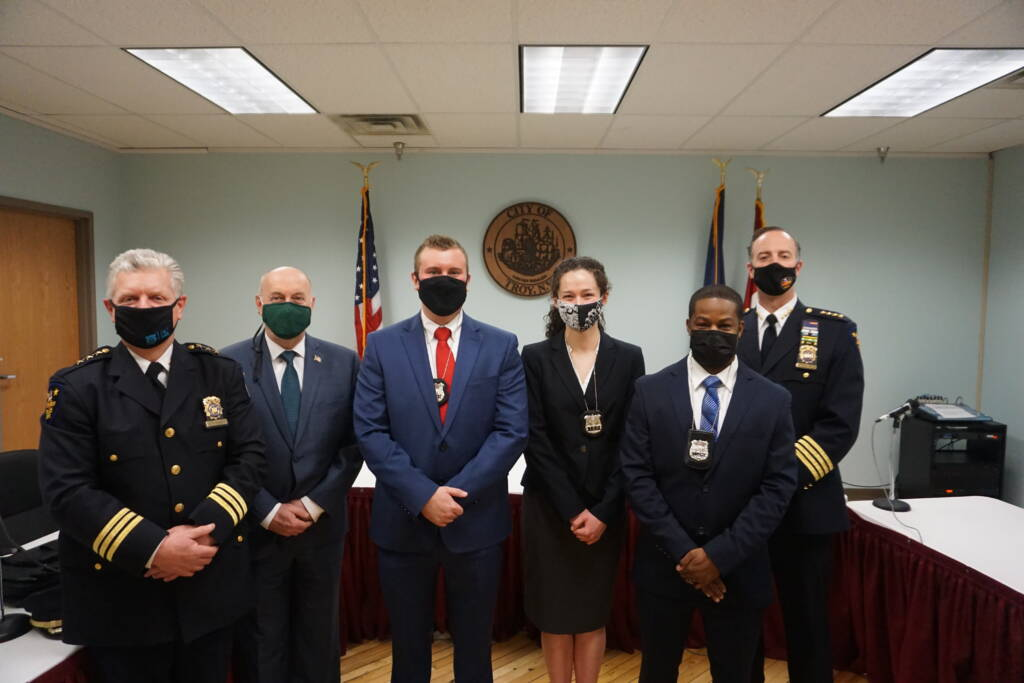Mayor Patrick Madden and Police Department leadership pose with three new police officers following a swearing in ceremony at City Hall. All are wearing masks due to COVID-19.